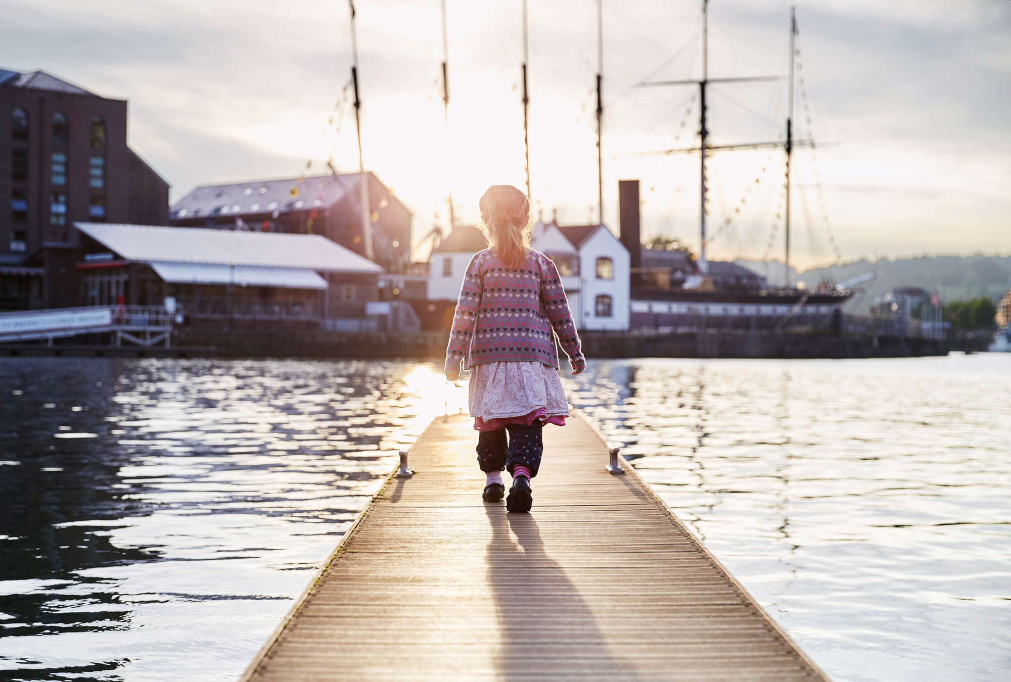 Girl walking on pier family portrait photography