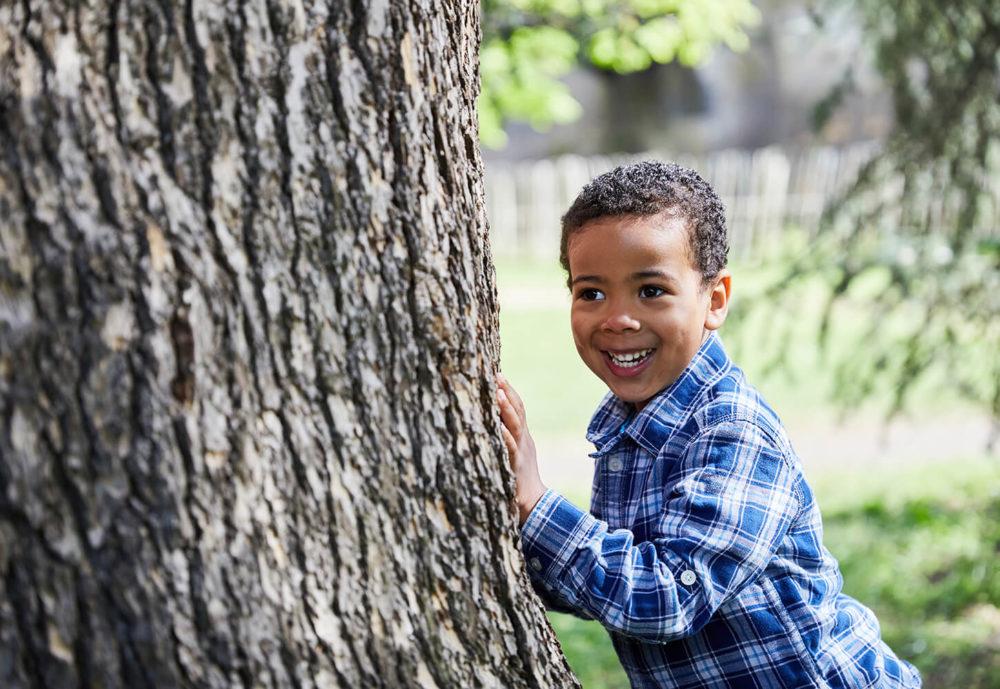 Hiding behind a tree